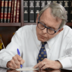DeWine at desk